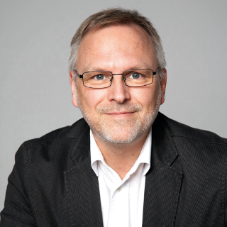 Dr. Erik Traupe